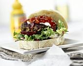 Hamburger with ketchup in ciabatta roll