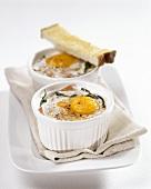 Eggs en cocotte with vegetables