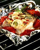 Spicy coley with onions and tomatoes, cooked in foil