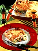 Vegetable lasagne with carrot figures for children