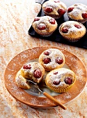 Cherry and marzipan buns with icing sugar