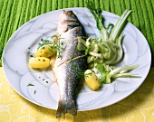 Sea bass cooked in aluminium foil with fennel salad