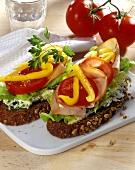 Open sandwich with cheese spread, turkey ham & vegetables