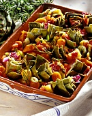 Oven-baked artichokes and potatoes with carrots