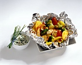 Chicken with vegetables cooked in foil with yoghurt sauce