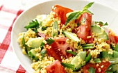Tomato and bulgur salad with cucumber and spring onions