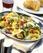 Ribbon noodles with artichokes, spinach & dried tomatoes