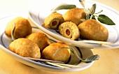 Crispy olive balls with sprigs of sage