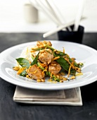 Fried diced salmon with mangetouts and pine nuts