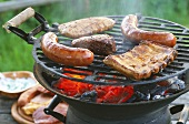 Meat and sausages on barbecue in open air