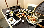 Kushi (Japanese kebabs) on laid table