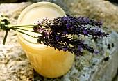 Lavender honey in jar, lavender flowers on top