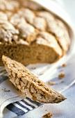 Brown coriander bread, a slice cut