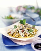 Asian egg noodles with beef and coriander leaves