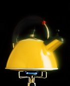 Yellow kettle on gas flame