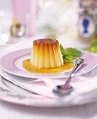 Crème caramel with fresh mint