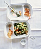 Green ribbon pasta with spinach and seafood