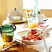 Hearty snack with sausage and sandwich spread on laid table
