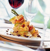 Fish and vegetable kebab with pink pepper
