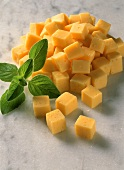 Diced cheese with fresh basil