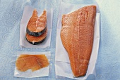 Salmon cutlet, smoked salmon & salmon fillet on waxed paper