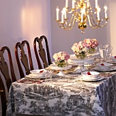 Festive table with white tableware and roses