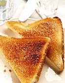 Toast triangles on white plate