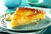 Piece of pear tart on blue plate