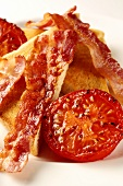 Toast with fried bacon and tomato