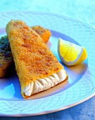 Breaded cod with lemon wedge