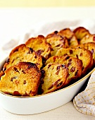 Bread pudding with raisins in baking dish