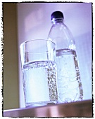 Mineral water in glass and plastic bottle