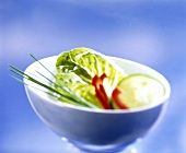 Salad leaves, cucumber, pepper and chives in dish