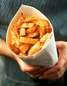 Person holding bag of chunky chips (potato wedges)
