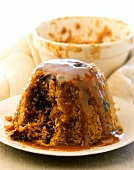 Steamed pudding with toffee sauce, England