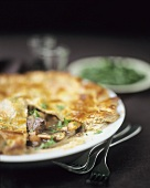 Beef pie with mushrooms and parsley, a piece cut