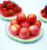Plums on slice of water melon