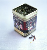 Green tea leaves in Asian tea caddy
