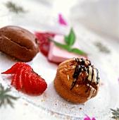 Dessert plates: chocolate mousse, cream puff, strawberry ice