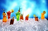 Various summer drinks on ice cubes