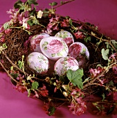 Easter eggs with rose decoration in spring wreath