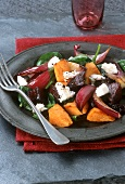 Salad with beetroot, pumpkin, onions, spinach, sheep's cheese
