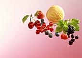 Scoop of vanilla ice cream, fresh berries and cherries
