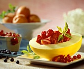Honeydew melon with fresh berries and mint