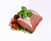 Lean raw pork with basil, peas and tomatoes