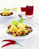 Pan-cooked pasta and vegetable dish with cheese and basil