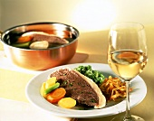 Boiled beef fillet with vegetables & rosti; white wine glass