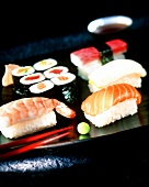 Sushi platter with wasabi, soy sauce and ginger