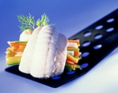 Steamed sole rolls with strips of vegetables