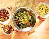 Mixed vegetables in wok among various dishes